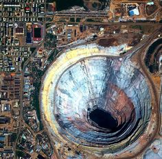 The inactive Mir diamond mine yawns in eastern Siberia. The 1,722-foot-deep pit is the second-largest excavated hole on the planet.