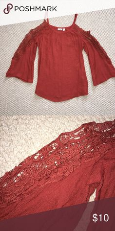 Top Pretty rust color cold shoulder blouse with crochet lace trim. Never worn. Brand new without tags. Cato Tops Blouses