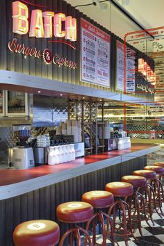 Batch Burgers and Espresso, located in Kirribilli, Australia and designed by Giant Design, this retro-styled fast food space had to have it all.