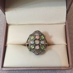 Stunning Opal and Peridot Ring Totally Stunning Opal and Peridot Ring  Beautiful Multicolored ❤️ Sterling Silver ☺️ Marked 925  Detailed ☀️ Great Gently Used Condition  Fits a 6.5-7 Best  Jewelry Rings