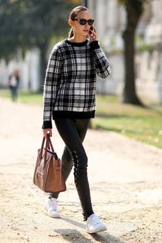 Classic plaid sweater paired with edgy lace-up skinny jeans