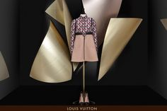 """Louis Vuitton Fall Windows """"WIND WINGS"""",curved metal panels resembling sails by Pritzer Prize-winning architect Frank Gehry, pinned by Ton van der Veer"""