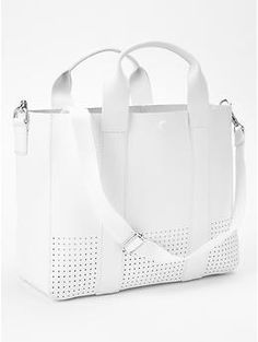 Perforated leather tote crossbody Wish the strap was a little thinner and more elegant but still cute!!