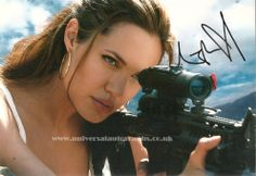 Signed photo of Angelina Jolie as Lara Croft in Tomb Raider You can buy this on the website http://www.universalautographs.co.uk/angelina-jolie-86-p.asp