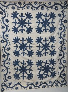 Appliqué blue and white quilt with floral and vine lot 56