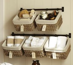 Wall basket system for bathroom storage.