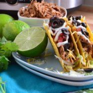 Slow-cooker-shredded-chicken to use in tacos and other recipes.  Use enchilada sauce rather than tomato sauce for better flavor.