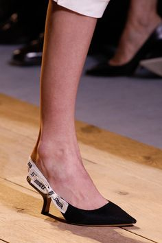 Dior Maria Grazia Chiuri embraced the ladylike shoe at her Dior debut, crafting an arched-heel slingback with J'Adior-printed ribbon trim. Against the herds of platforms, these elegant mules were a breath of fresh air.