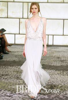 "Brides.com: . Trend: Deep V. ""Sierra"" sleeveless sheath wedding dress with a deep v-neckline, beaded bodice, and translucent flutter details on the skirt, Rivini"