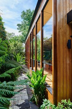 A simple pavilion structure in a well-established garden setting. Working with an existing 1880s Bluestone Terrace house in Williamstown, Victoria, designers Altereco Design created a modern space for daily living, which appreciated and enjoyed its connection with a well-established landscaped backyard.