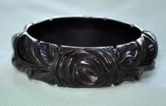 SALE Black Bakelite Bangle Deeply Carved Roses by hotneonfig, $212.50