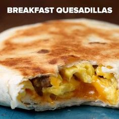Make-Ahead Breakfast Quesadilla. Make-ahead Breakfast Quesadilla Recipe by Tasty. Here's what you need: sausage link, egg, flour tortilla, shredded cheddar cheese Breakfast Quesadilla, Quesadilla Recipes, Breakfast Crunchwrap, Breakfast Tortilla, Make Ahead Breakfast Burritos, Freezer Breakfast Sandwiches, Breakfast Party, Best Breakfast, Breakfast And Brunch