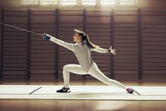 Fencing ~ Perfect Extended Lunge!  Notice the security of her back foot . . .  no broken ankles there!