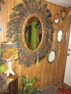 My sister and I hot-glued 88 peacock feathers to this thrift-store mirror. It is the queen of my mirror collection