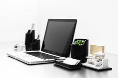 http://www.core77.com/blog/materials/bases_polystone_plastic_stone_desktop_organizers_28099.asp