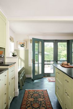 This kitchen extension borrowed space from an existing deck. French doors and sidelights enhance the sense of spaciousness.