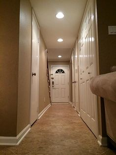 The hallway from the living room looking to the front door. On the left is a 1/2 bath on the right bifold doors for utility closet. & Recessed Lighting Basics - A spacing of 6u0027 to 8u0027 will provide even ...