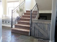 Wooden Barn Door Baby Gate Installed On A Metal Stair Banister, Built By Chelsey, Plans By Remodelaholic Baby Gate For Stairs, Barn Door Baby Gate, Barn Door Decor, Diy Baby Gate, Diy Barn Door, Diy Stair Railing, Stair Gate, Railings, Building A Barn Door