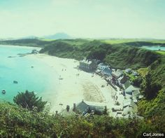 Perfectly preserved and rich in natural beauty, the old fishing village of Porthdinllaen sits resplendent on the Llŷn Peninsula. The sandy beach sprawls along a perfect cove and natural harbour. North Wales, Fishing Villages, Welsh, Natural Beauty, Old Things, British, River, Places, Nature