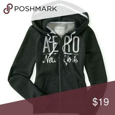 New authentic Aeropostal hoodie sweatwer gray XS MSRP = $49.50/ HOODIE AS SHOWN ON STORE PRICE TAG ATTACHED EMBROIDERED / APPLIQUE/ RAISED LETTER AERO NY LOGO ACROSS CHEST  70% COTTON, 30% POLYESTER  FRONT POCKETS, DRAWSTRING, RELAXED FIT Aeropostale Jackets & Coats Puffers