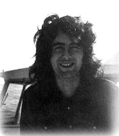 Jimmy Page in a rare pic out on a boat on the ocean