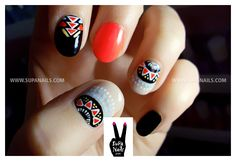 Geometric skittle manicure painted freehand: orange black turquoise white taupe red yellow