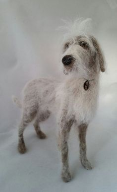Commission a sculpture of a dog - needle felted from wool with a wire armature frame. Please supply as many photos as possible. Sculpture approx 7 to 8 inches tall. These sculptures are not intended as toys and are not suitable for young children. Listing price is for one dog.