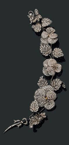 A large and elegant antique gold, silver and diamond trembleuse brooch, mid to late 19th century. 23.3cm long. #antique