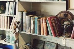 These books look like they've found a temporary home in an old antique shop. I can almost feel the dust on my fingertips, smell the must, and imagine the history lurking on each page.