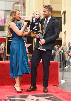 Scene stealer: Though the event was about Ryan's accomplishments the A-list parents were much were enamored with their adorable daughter