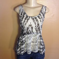 Cute peplum tank Perfect summer peplum tank.  So light and airy.  Colors are black and white with faded look.  In great condition. Bundle and save.  Sorry no trades and no holds.  Please use offer to negotiate,  all reasonable offers considered.  Please no low balling. Chloe K Tops Tank Tops
