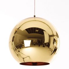 Illuminating round pendant lamp from Tom Dixon. The unique Copper Bronze Pendant Light is made from polycarbonate and designed to sit on the floor. It is vacuum metallised with a copper interior and brass body. This creates a complementary colour effect on the light. The lamp will add sculptural elegance with its enriching and reflective look. It will add contemporary designer style to your interior surroundings. Requires: 1 x E27 42w (max 60w) halogen low-energy clear bulb. Features: • 2.5m…