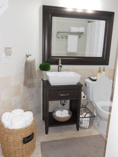 On a budget bathroom, This bathroom is a down stairs guest bathroom, I was going for a spa look.  I still have a couple more things to add l...