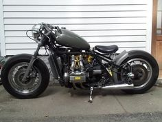 GL 1000 Bobber: I chopped and bobbed my 1975 GL 1000 Honda Goldwing.  Modifications include: hardtail rear frame section, 16 balloon tires, modified frame backbone, mustang