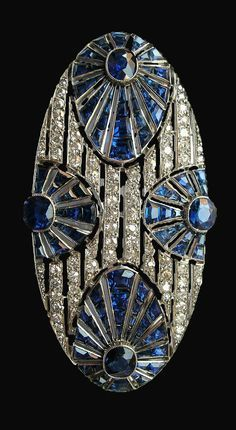An Art Deco sapphire and diamond brooch. #ArtDeco