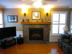 Mantle on fireplace, TV next to fireplace