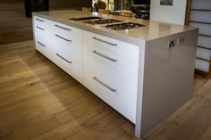 Ceasarstone 9 2230 Linen™ - countertop with white cabinets and light wood floors.