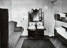Second Class outside two-berth Cabin - Titanic (convertible long sofa bed, two berths and a timber cabinet containing two basins with hot and cold water as well as drawers and a folding mirror)