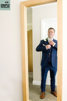 The groom getting ready. Wedding Photography at Tulfarris Hotel & Golf Resort by Couple Photography