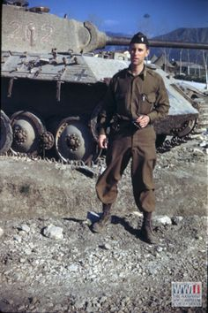 US serviceman Boylhart in front of knocked out German panther tank in Volturno Valley.