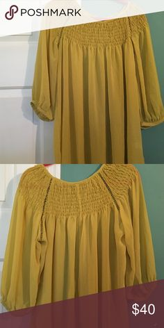 """Anthro flowy smocked at the neckline top. Anthro flowy mustard gold top with smocked neckline, 3/4"""" sleeves. Anthropologie Tops Tunics"""