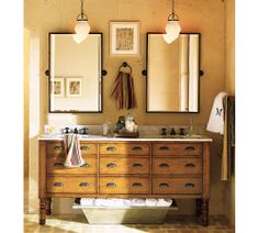 Like the hanging pendants over the sinks & the dresser made into vanity.