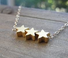 Gold Star Necklace. Imaagine if these were earrings?!!!