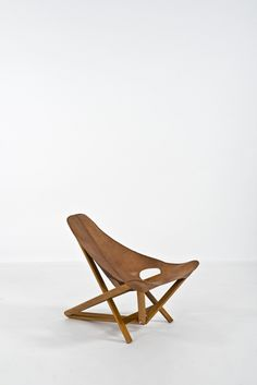 Anonymous; Wood and Leather Chair Attributed to Rima, 1960s.