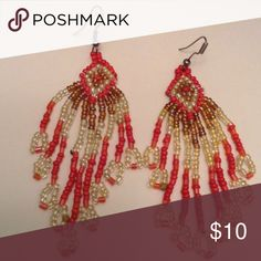 Earrings coral and glass bead tassels Gorgeous hand made one of a kind urban design tassel bead earrings made of coral and glass tiny seed beads. A definite eye catcher. Measures 3 inches long. Excellent clean condition. Coral bead tassels Jewelry Earrings