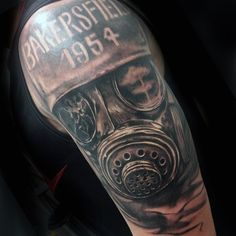 Bakersfield 1954 Gas Mask Tattoo On Arm Of Man