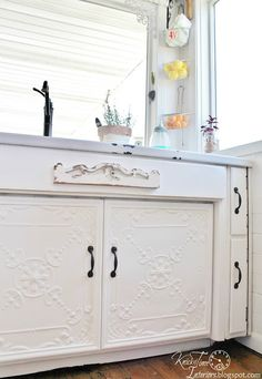 Ceiling Tile Cabinet Doors in Farmhouse Kitchen - an easy way to give vintage style to ugly cabinets! ~ via KnickofTime.net