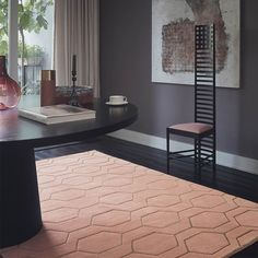 A Wedgwood rug with a geometric pattern which brings out this decadent design.