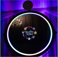 Magic Mirror Photo booth with LED wash lighting. Reflections Entertainment