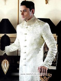 Off-white #wedding #sherwani for men with embellished collar and buttons detail on front http://www.needlehole.com/off-white-wedding-sherwani-for-men.html #Deepak perwani sherwani designs and sherwani uk for men. Latest pakistani #wedding sherwani suits and indian men's sherwani collection by deepak perwani sherwani stores